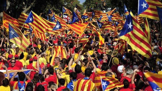Catalans hold Catalonia pro-independence flags during celebrations of Catalonia National Day (Diada) in Barcelona on 11 September 2014