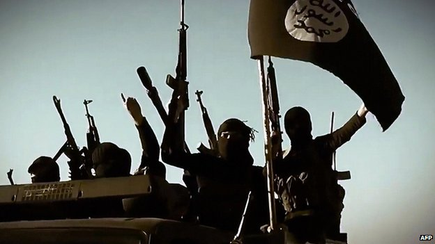 IS militants raise weapons in Anbar province, Iraq - undated image from propaganda video