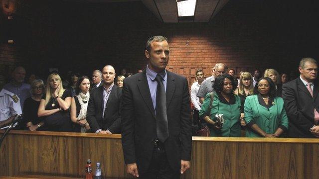 Oscar Pistorius awaits the start of court proceedings in the Pretoria Magistrates court February 19, 2013