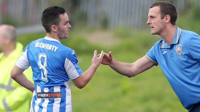 Neil McCafferty celebrates with Coleriane manager Oran Kearney