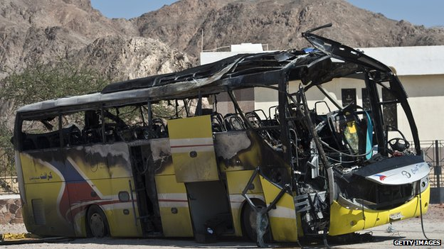 The wreckage of a tour bus that was targeted by a suicide bombing on 16 February is seen in the Egyptian south Sinai resort town of Taba on 18 February 2014.