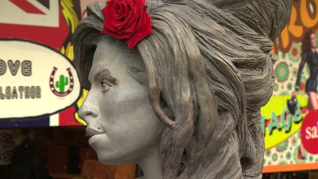 Close up side view of Amy Winehouse statue in Camden