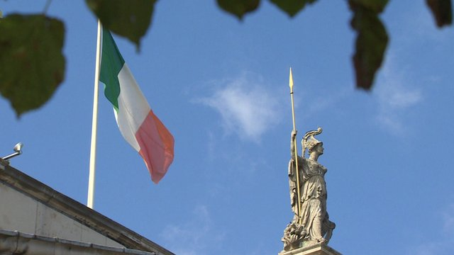 Flag and statue above Irish post office
