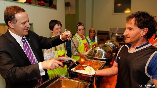 New Zealand Prime Minister John Key serves dinner to volunteers following the Christchurch earthquake on 7 September, 2010