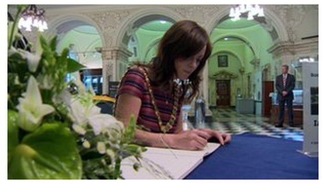 Lord Mayor of Belfast Nicola Mallon signs the book of condolence