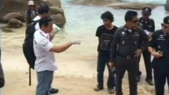 Policemen on a beach
