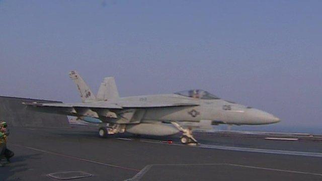 An American plane on an aircraft carrier