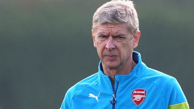 Arsenal manager Arsene Wenger looks on during training