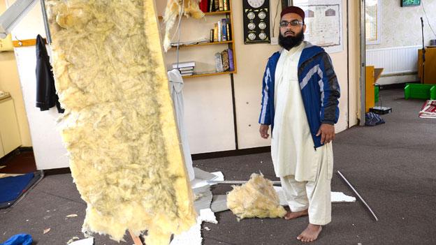 Imam Hussain Ahmad surveys the damage inside the centre