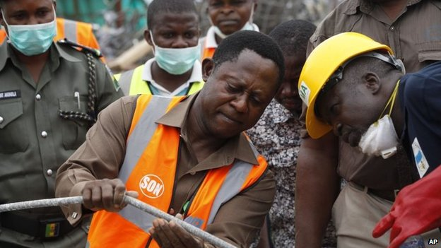 Officials inspecting the site of the building collapse, Lagos, Nigeria 16 September 2014