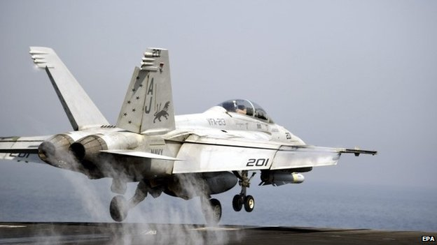 US Navy F/A-18 Hornet takes off from USS George HW Bush - 15 August