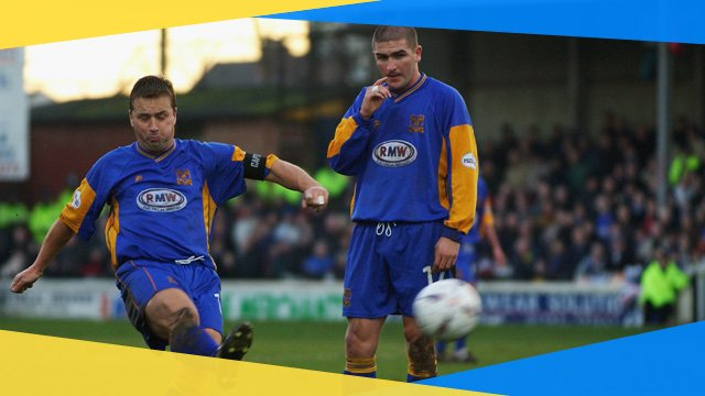 Shrewsbury's Nigel Jemson strikes his free-kick against Everton