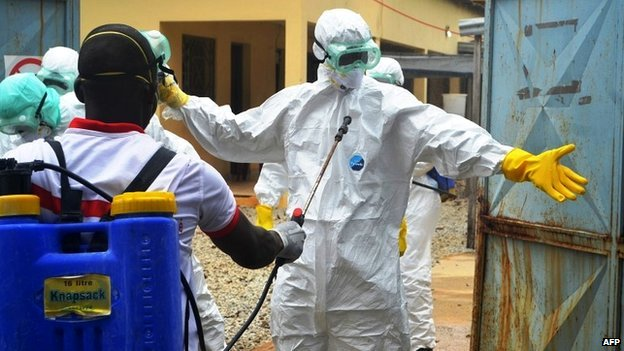 Guinean health workers wearing protective suits at a hospital in Conakry - 14 September 2014