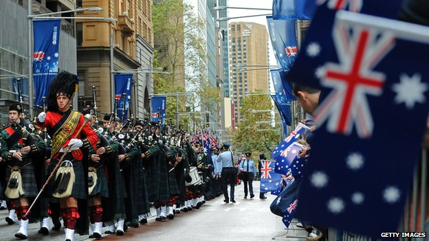 A Scottish highlands band marches in the 95th Anzac Day parade through Sydney on 25 April 2010.