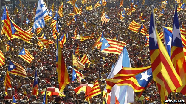 Catalans holding independentist flags (Estelada) gather on Gran Via de les Corts Catalanes during celebrations of Catalonia National Day (Diada) in Barcelona on 11 September 2014.
