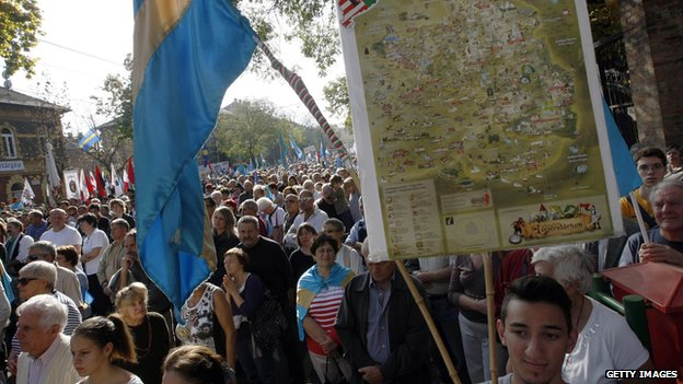 Hungarians hold Hungarian and Transylvanian flags as they take part in a demonstration for the autonomy of Transylvanian territory from Romania in Budapest, Hungary on 27 October 2013.