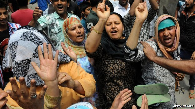 Kashmiri supporters chant slogans during a protest march against Indian rule in India-controlled Kashmir in Srinagar on 23 June 2014