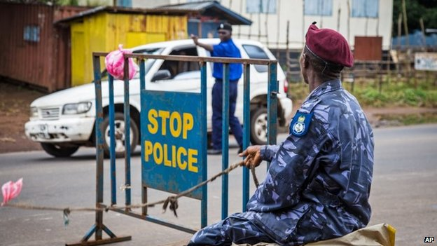 Police guard a roadblock in Freetown, Sierra Leone, 19 September 2014