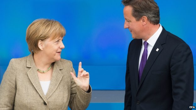 British Prime Minister David Cameron (R) and German Chancellor Angela Merkel meet during the Nato summit in Newport, South Wales, on 4 September 2014.