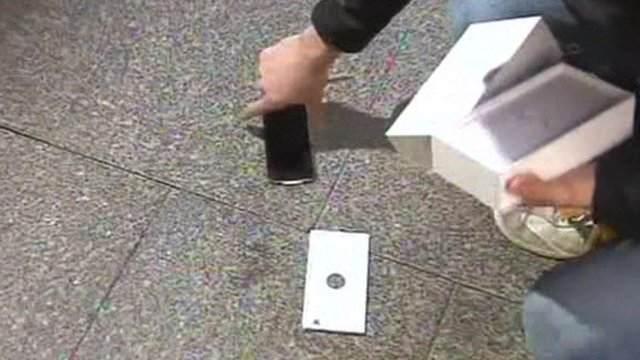 Man reaches for dropped iPhone