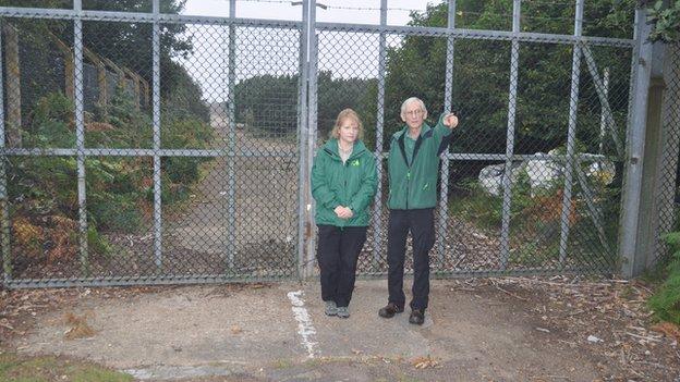 Olivia English and Nigel Turner outside RAF Woodbridge's East Gate