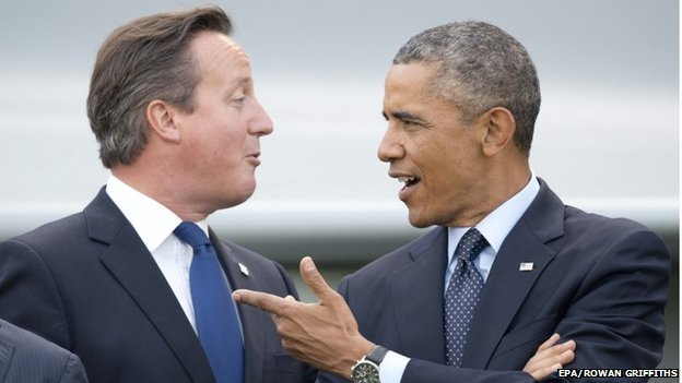 US President Barack Obama (right) and British Prime Minister David Cameron together at the 2014 NATO summit in Newport, south Wales on 5 September 2014.