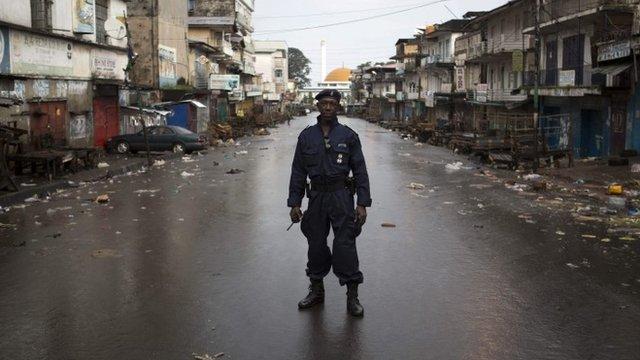 Police officer on deserted street in Freetown