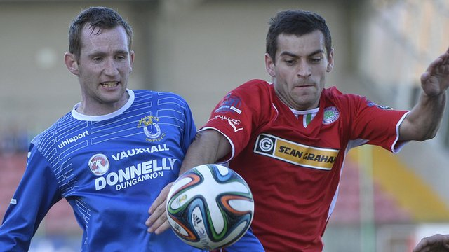 Dermot McCaffrey in action against Cliftonville's David McDaid