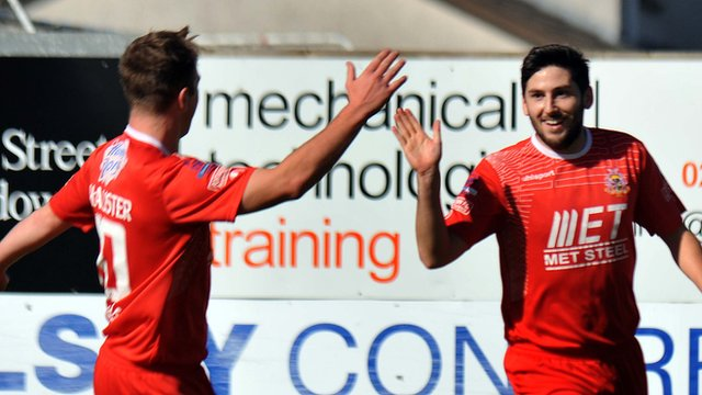 Portadown's Mark McAllister celebrates with goal scorer Sean Mackle