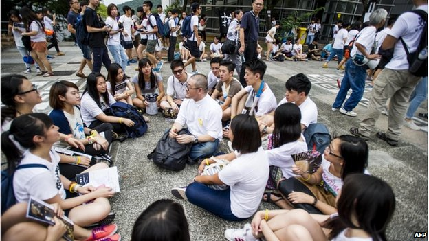 Students gather and sing freedom songs during a strike at the Chinese University of Hong Kong on 22 September 2014.