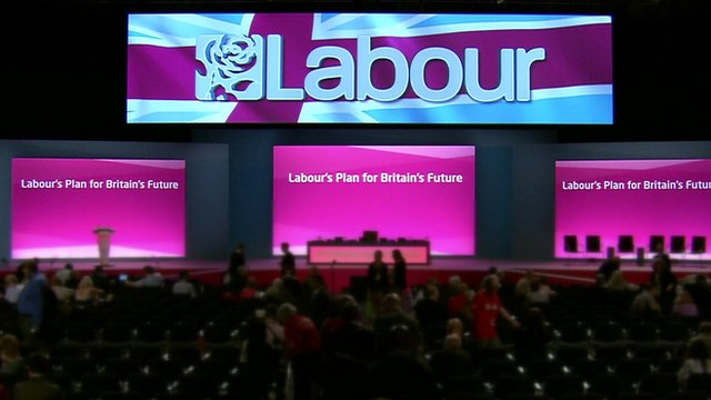 Labour Party conference hall with logo and slogan 'Labour's Plan for Britain's Future'
