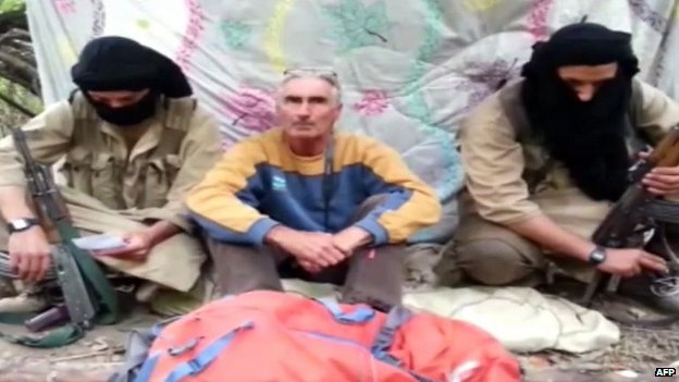Herve Gourdel (centre) with two men thought to be part of the group holding him