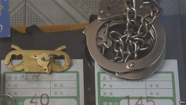 Finger and cuff restraints on sale in a security equipment shop in Beijing on 19 September 2014