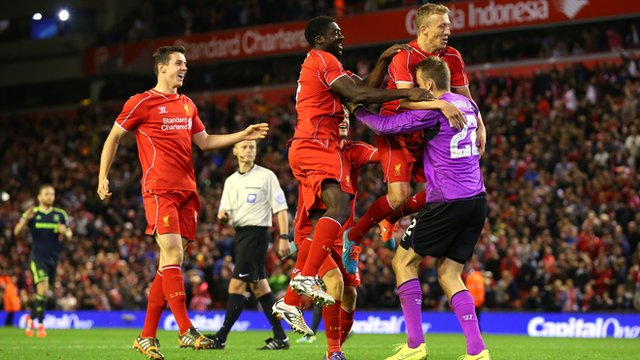 Liverpool players celebrate after winning on penalties against Middlesbrough in the Capital One Cup