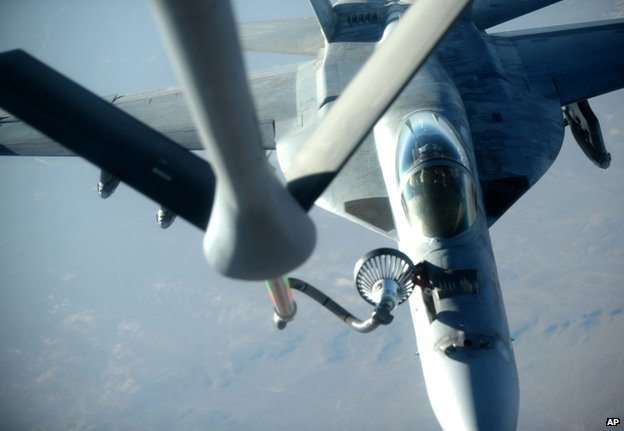 A US Navy F-18E Super Hornet receives fuel from a KC-135 Stratotanker over north Iraq, 23 September