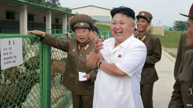 North Korean leader Kim Jong-un (C) reacting as he visits the North Korean People's Army Breeding Station No. 621