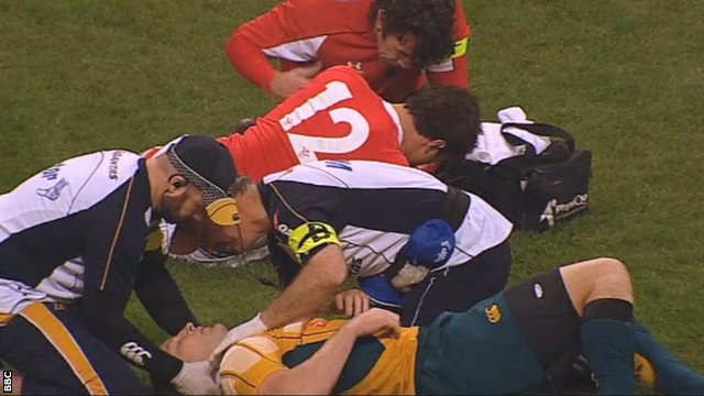 Jamie Roberts is treated on the pitch