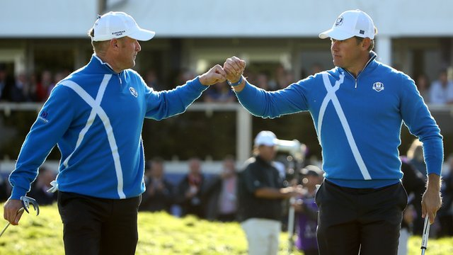 Europe's Jamie Donaldson and Lee Westwood celebrate on the 12th hole