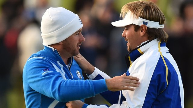 Graeme McDowell and Victor Dubuisson celebrate their foursomes win on Friday afternoon