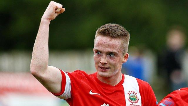 Linfield's Aaron Burns celebrates his goal against Ballinamallard at Ferney Park