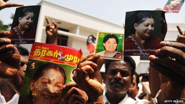 Supporters of All India Anna Dravida Munnetra Kazhagam (AIADMK) hold portraits of party leader J. Jayalalitha in Chennai on 13 May 2011