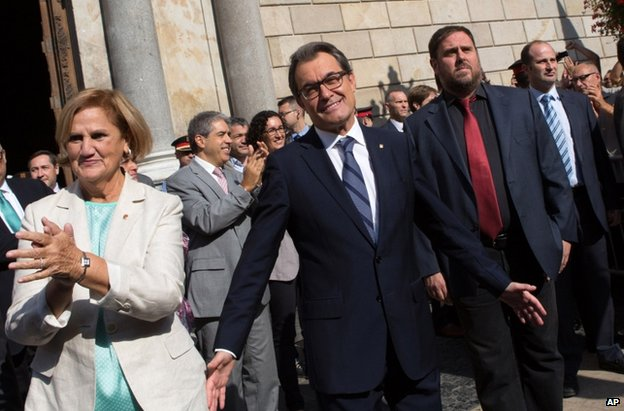 Artur Mas emerges after signing the decree at the Generalitat Palace in Barcelona, 27 September