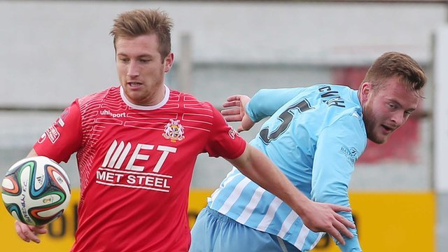 Match action from Portadown against Warrenpoint Town at Shamrock Park