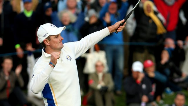 Justin Rose of Europe celebrates as he halves his match on the 18th green