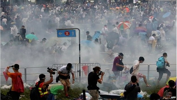 People disperse after police fired tear gas, 28 September