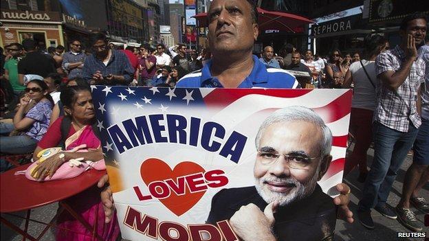 Supporter holds America Loves Modi sign in Times Square, New York. 28 Sept 2014