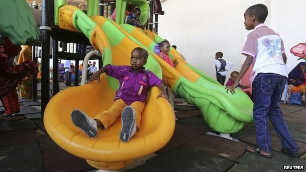 """Children play in celebration after attending Eid al-Fitr prayers to mark the end of the fasting month of Ramadan in Somalia""""s capital Mogadishu, July 28, 2014."""