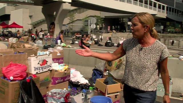 Ali Moore pointing at piles of supplies