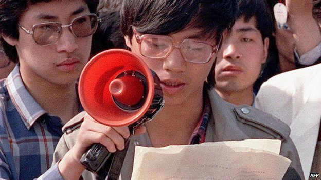 File photo from 1 May 1989 shows Chinese student-leader Wang Dan addressing foreign correspondents in Beijing
