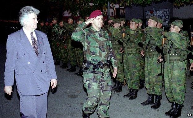 Radovan Karadzic (L) reviews the Serbian Volunteers Guard in Bijeljina (Oct. 23, 1995)